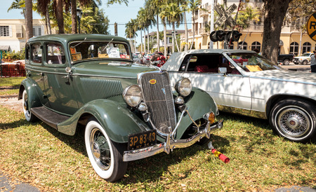 Naples, Florida, USA – March 23,2019: Green 1934 Ford at the 32nd Annual Naples Depot Classic Car Show in Naples, Florida. Editorial only. Sajtókép
