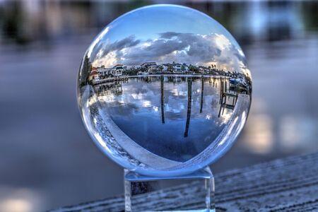 Crystal ball of Boats docked at a Marina near Venetian Bay in Naples, Florida at sunrise. Zdjęcie Seryjne