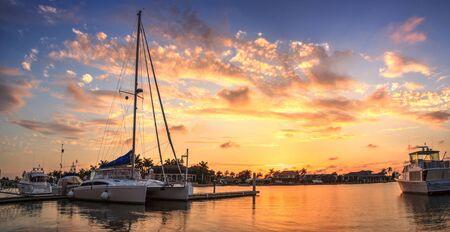 Sunset over the boats in Esplanade Harbor Marina in Marco Island, Florida