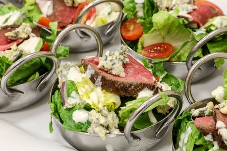 Steak and blue cheese spring green salad at a lunch buffet