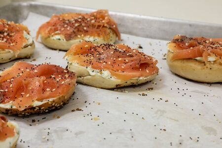 Smoked salmon lox and cream cheese on a bagel at a breakfast buffet
