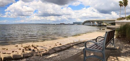 Park bench at Gulf of Mexico Drive on Long Boat Key in Sarasota, Florida