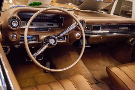 Punta Gorda, Florida, USA – October 13, 2019: Gold 1960 Cadillac Eldorado Biarritz displayed at the Muscle Car City museum. Editorial Use Stock Photo - 132991277