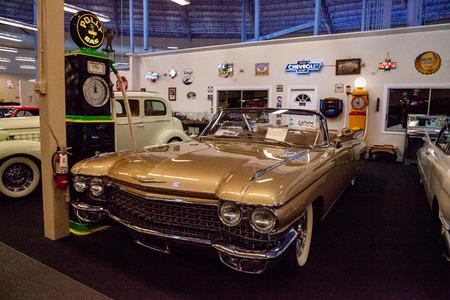 Punta Gorda, Florida, USA – October 13, 2019: Gold 1960 Cadillac Eldorado Biarritz displayed at the Muscle Car City museum. Editorial Use Stock Photo - 132991335