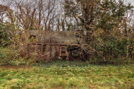 Run down dilapidated horse barn on an abandoned farm in New England.