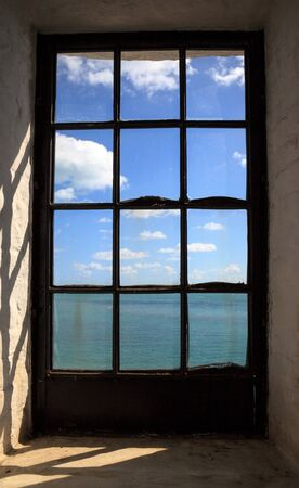 Window from inside the Cape Florida Lighthouse at Bill Baggs Cape Florida State Park at Key Biscayne in Miami, Florida.