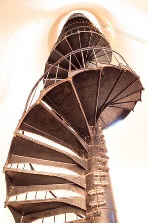 Spiral stairs inside the Cape Florida Lighthouse at Bill Baggs Cape Florida State Park at Key Biscayne in Miami, Florida.