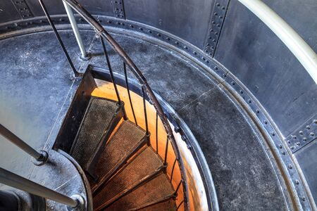Spiral stairs inside the Cape Florida Lighthouse at Bill Baggs Cape Florida State Park at Key Biscayne in Miami, Florida. 스톡 콘텐츠