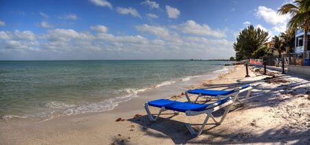 Beach Chairs overlook the ocean at Anna Maria Beach on Anna Maria island, Florida. Фото со стока