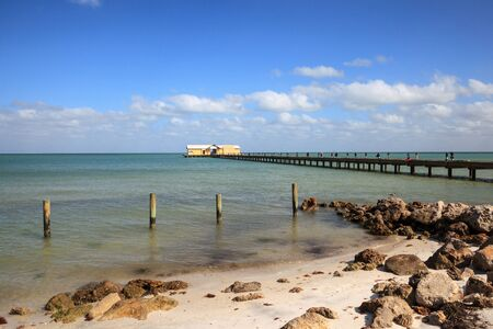 Blue sky over the Anna Maria Island City pier on Anna Maria island, Florida. Фото со стока