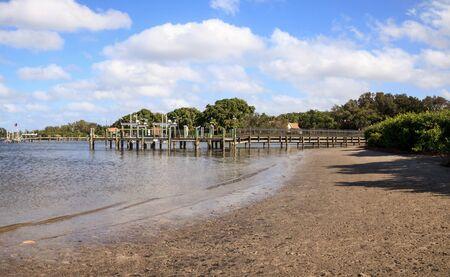 Clouds and Blue sky over Jones Bayou pier on Anna Maria island, Florida. Фото со стока