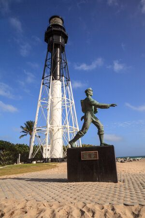 Hillsboro Inlet, Florida – January 12, 2020: Statue of the barefoot mailman James E. Hamilton of Hillsboro Inlet who lost his life while crossing the inlet in 1887. Editorial Use.