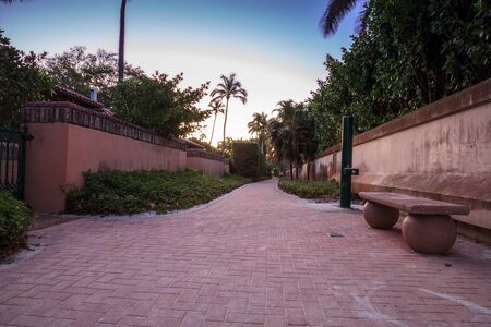 Paved walkway to the beach in Port Royal of Naples, Florida in Spring. Stock Photo