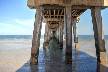 Naples, Florida, USA – May 9, 2020: Under the Empty Naples Pier after it was closed off due to the Covid 19 virus outbreak in Naples, Florida