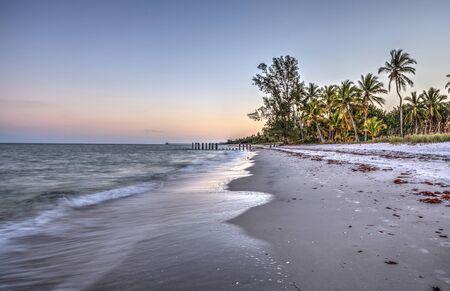 Shoreline of Port Royal Beach at sunrise in Naples, Florida