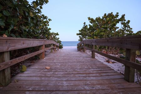 Boardwalk leading to beach in Port Royal of Naples, Florida in Spring.