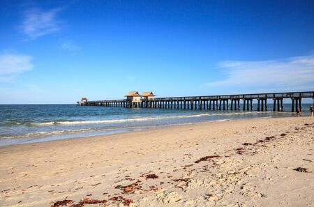 Naples, Florida, USA – May 9, 2020: Empty Naples Pier after it was closed off due to the Covid 19 virus outbreak in Naples, Florida