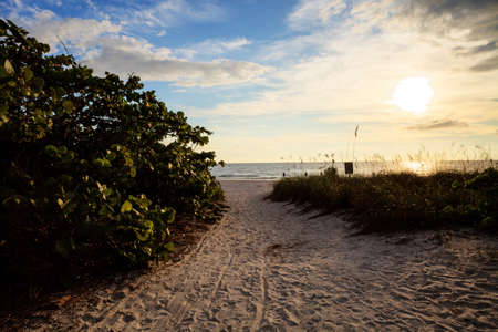 Pathway leads down to the white sand of Barefoot Beach in Bonita Springs, Florida
