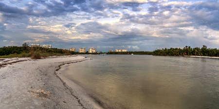 Dark sky over the waters off Barefoot Beach in Bonita Springs, Florida