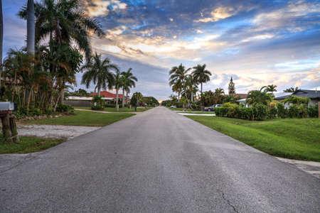 Naples Park street at sunset leading toward the ocean in Naples, Florida