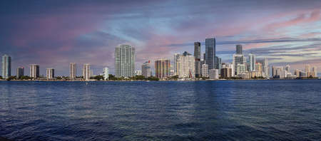 Sunset View of the city of Miami over the ocean on the way onto Key Biscayne in Miami, Florida.