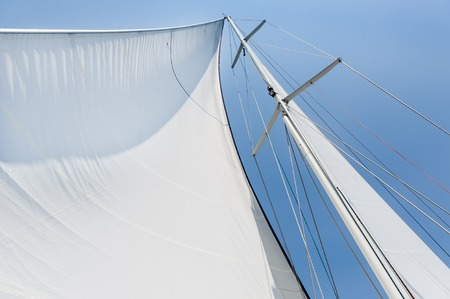 Genoa sail is hoisted on sailing boat mast