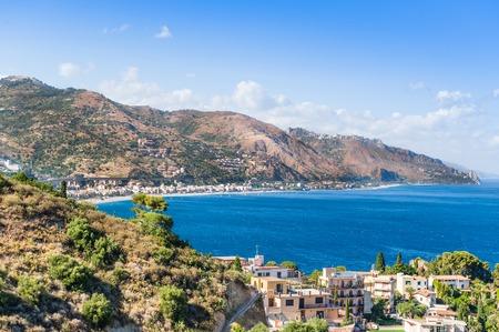 Taormina, Sicily, Wonderful view of seaside and resort beach. photo