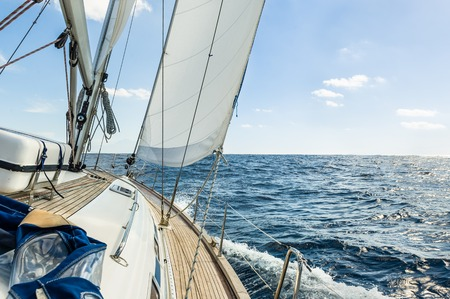 vessels: Sailing boat deck with hoisted sails and teak deck