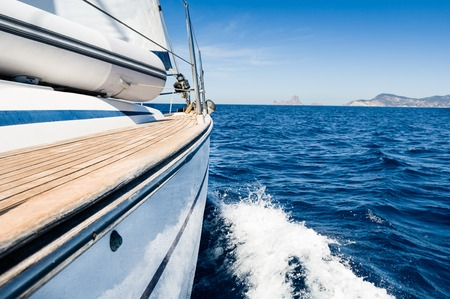 Sailing boat in fast motion view from board