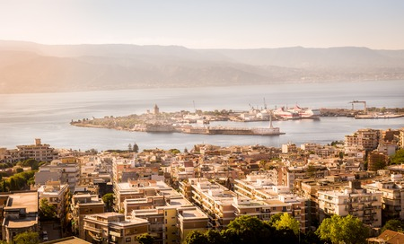 Messina city, harbour and channel view in warm light just before sunset