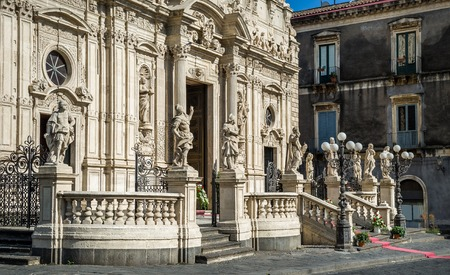Acireale duomo with sculptures on facade. Sicily, Italy