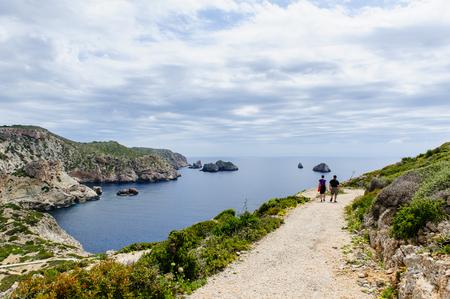 Travelers couple walking. Cabrera island. Mediterranean sea.