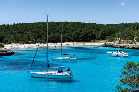 Charter boat anchorage at Cala Mandrago, Mallorca Island Stock Photo - 31651639