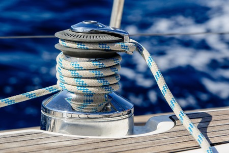 Sailing boat winch with rope.  Close up yacht equipment