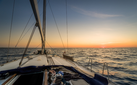 Sunset observation from the sailing boat deck photo