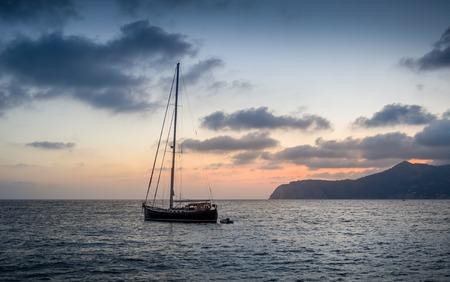 Classic sailing boat stay at anchor in Ibiza island bay photo