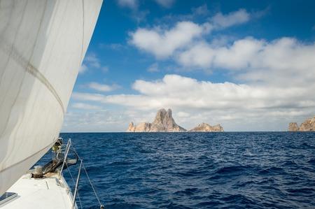 Cruising yacht sailing near Ibiza. Balearic islands, Eivissa, Spain photo
