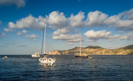 Sailing yachts stays at anchor in Mediterranean sea bay. Balearic islands, Spain photo