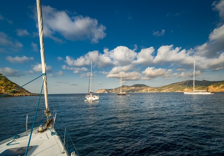Sailing yachts stays at anchor in Mediterranean sea bay. Balearic islands, Spain photo