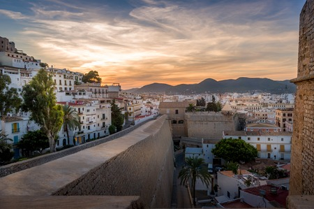 Dalt Vila and Almudaina castle in Ibiza old town. Vivid sunset scene.
