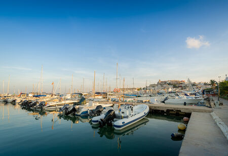 Wood pier with recreational boats in Eivissa marina photo