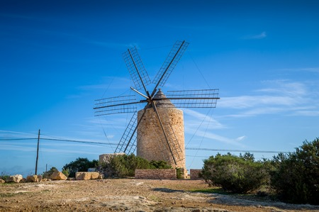 wind powered building: Old stone windmill at Formentera island. Balearic islands, Spain