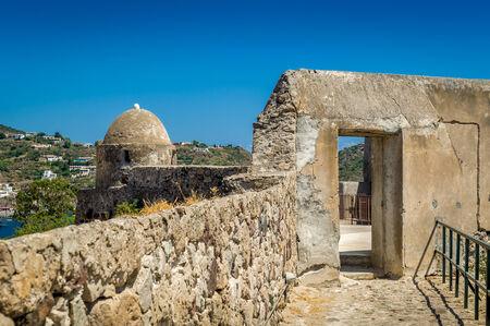 touristic: Ancient fort walls at Lipari island harbor. Popular touristic places of Sicily, Italy