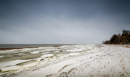 leningradskaya: Baltic sea shore in ice and snow in the beginning of winter