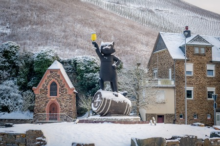 Winter view of cat statue holding glass of beer monument in Germany photo