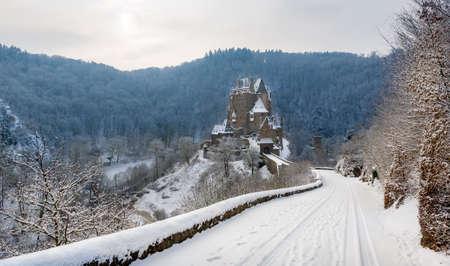 burg: Snowy winter road to fairy tale castle Burg Eltz. Germany Editorial