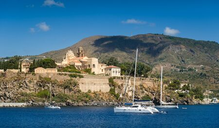 lipari: Lipari medieval town and sailing boats view from the water. Sicily, Italy Editorial