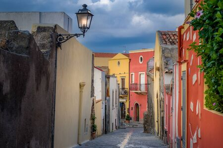 Old narrow colorful street in the Milazzo. Sicily, Italy