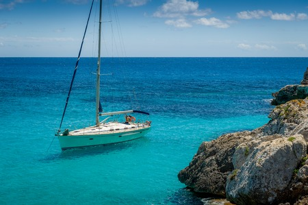 Sail boat at anchor in Mediterranean sea coast. Mallorca island, Spain Standard-Bild