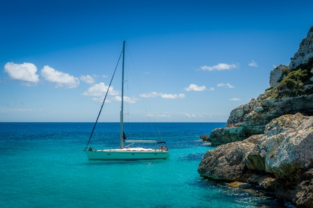 Recreational sail boat in Mediterranean sea coast. Mallorca island, Spain 版權商用圖片